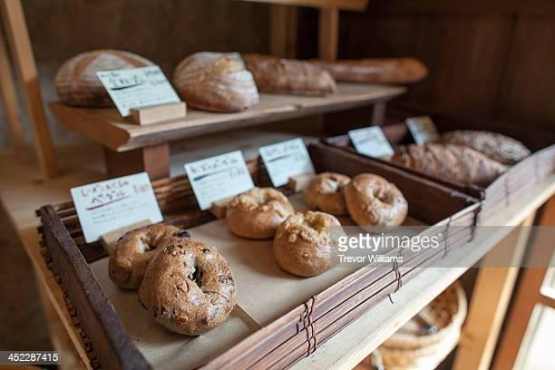 stone oven baked bread on display - パン屋 ストックフォトと画像