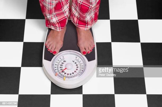 15 stone overweight woman on bathroom scales