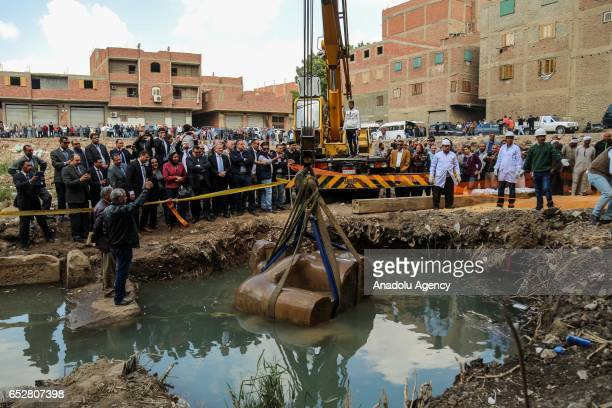 Stone parts of a huge statue possibly symbolizing Ramses II are being unearthed after they were discovered at the ancient Heliopolis archaeological...