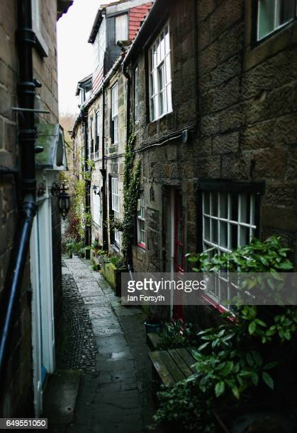 A stone path leads between cottages in Robin Hood's Bay on the North Yorkshire coast on March 8 2017 in Robin Hood's Bay United Kingdom Robin Hood's...
