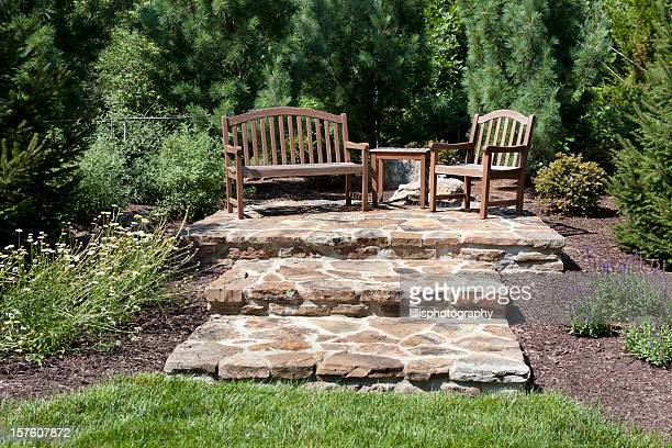 Stone Patio and Benches in Formal Garden