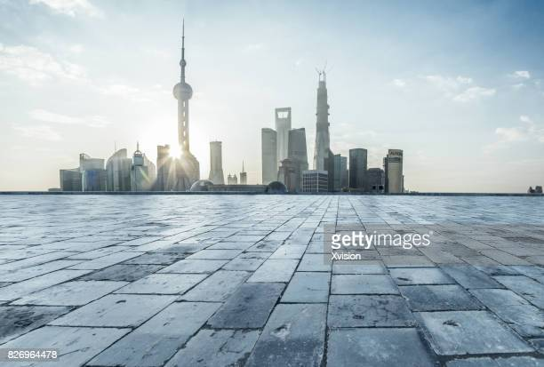 stone paved platform in front of Shanghai pudong near sunrise
