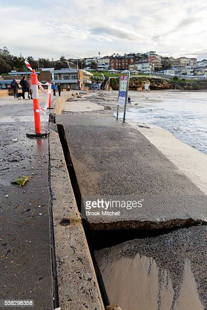 A stone pedestrian ramp broken in half at Bronte Beach on June 6 2016 in Sydney Australia Torrential rain over the weekend saw streets and homes...