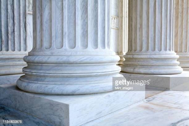 stone pillars - politics concept stock pictures, royalty-free photos & images