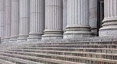 Stone pillars row and stairs detail. Classical building facade