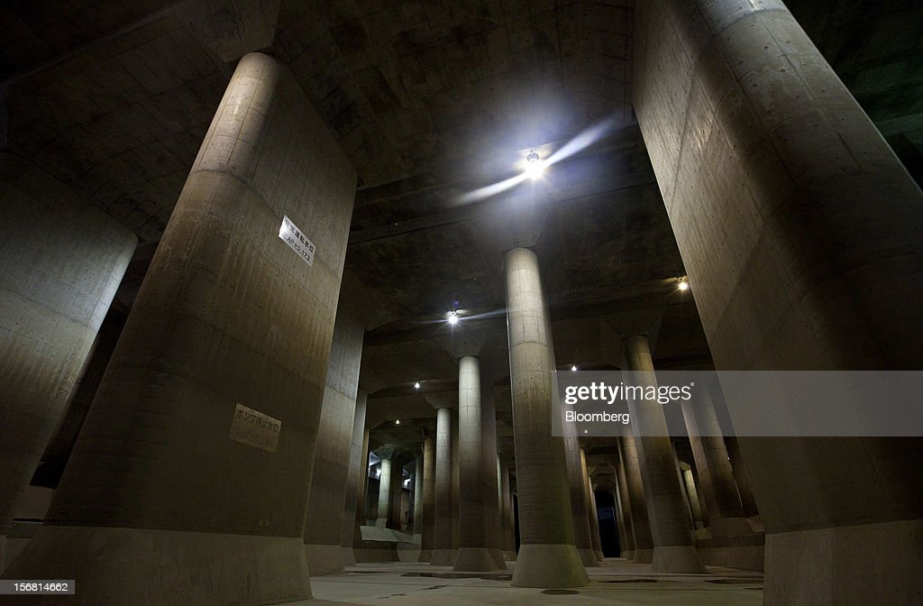 Stone pillars stand in the surge tank area of the Metropolitan Area Outer Underground Discharge Channel in Kasukabe City, Saitama Prefecture, Japan, on Wednesday, Nov. 21, 2012. The facility called 'Underground Temple' was constructed to protect the capital Tokyo against flooding and is one of the largest underground water diversion facilities in the world. Photographer: Tomohiro Ohsumi/Bloomberg via Getty Images