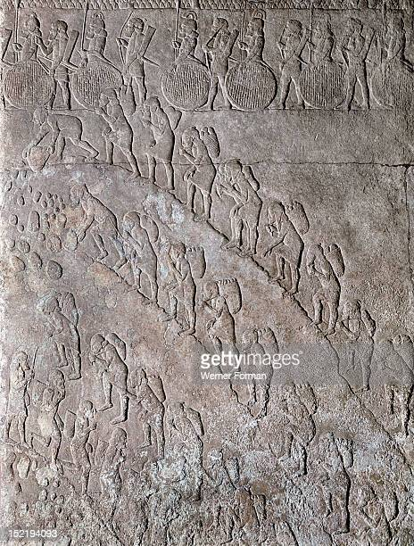 Stone relief from the palace of Sennacherib Prisoners under guard work in a stone quarry Assyrian Late Assyrian c 700 BC Nineveh Assyria Ancient Iraq