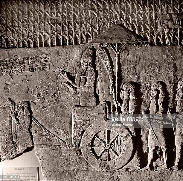Stone relief from the palace of Sennacherib The king supervises the work of extracting stone from a quarry for the palace sculptures Assyrian Late...