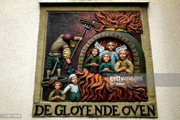 a stone relief of the story de gloyende oven depicts the blazing furnace, referring to nebuchadnezzar, shadrach, meshach and abednego from the book of daniel. - clemence hollande photos et images de collection