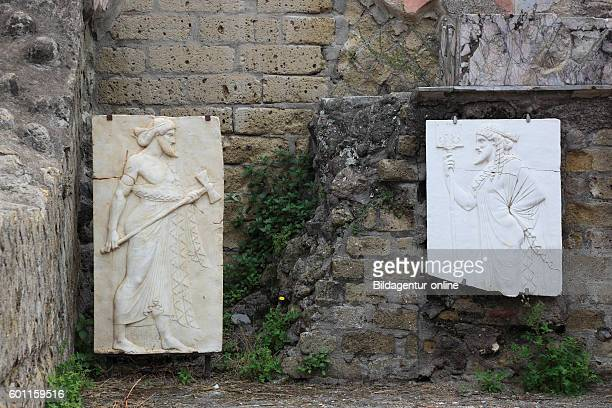Stone reliefs in the Holy area in the ruins of Herculaneum Campania Italy