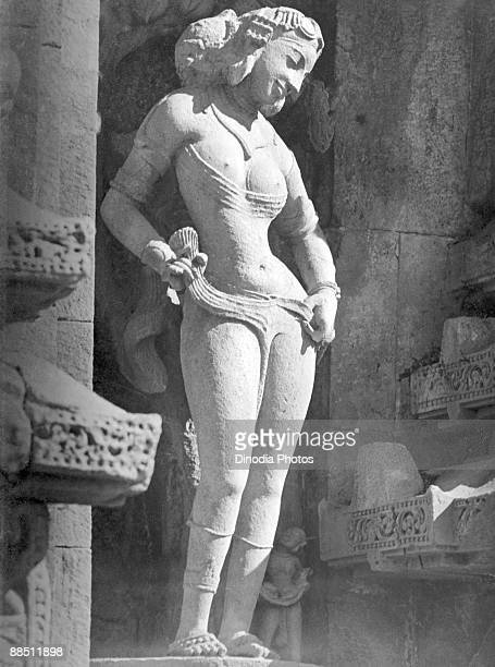A stone sculpture at Lingaraj Temple in Bhubaneshwar Orissa India 1940s The temple is sacred to the Hindu god Shiva