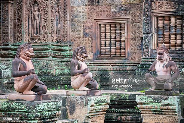 stone sculpture in banteay srei temple the red sandstone temple of siem reap, cambodia. - khmer art stock photos and pictures