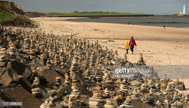 Stone stacks built by members of the public whilst out on the daily walks during the COVID-19 pandemic, are pictured on the beach in Whitley Bay,...