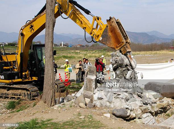 A stone statue is demolished at a bank of Chikuma River on April 24 2015 in Ueda Nagano Japan Ueda Police Station indicted a man over suspicion of...