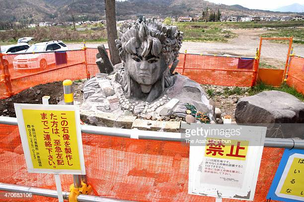 A stone statue is surrounded by fense at a bank of Chikuma River on April 22 2015 in Ueda Nagano Japan Ueda Police Station indicted a man over...
