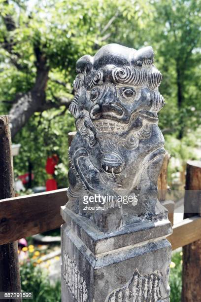 A stone statue of a leaguer on the ancient street of bailu, xi 'an, China