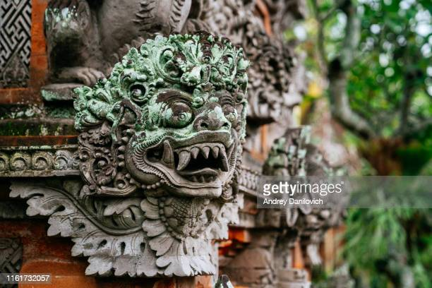 stone statue of an ancient deity. bali stone carving. - god stock pictures, royalty-free photos & images