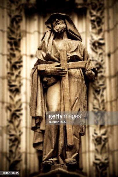 Stone Statue of Monk Holding Cross at Cathedral