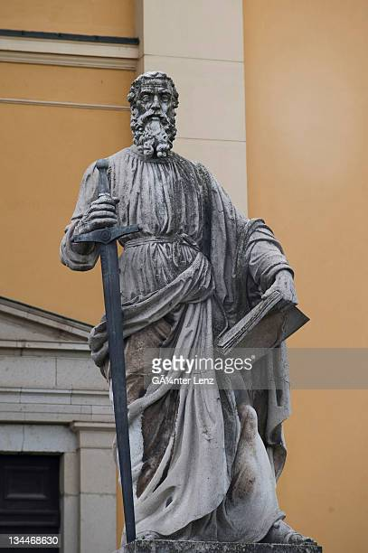 stone statue of st. peter in front of the basilica, eger, hungary, europe - sword in the stone stock photos and pictures