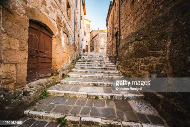 stone steps in an old etruscan town, tuscany, italy - centro storico foto e immagini stock