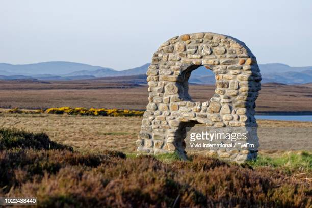 stone structure on field against sky - number 8 stock pictures, royalty-free photos & images