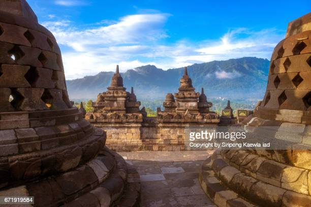 Stone stupas and small pagodas on the wall at the Borobudur temple, Central Java, Indonesia.