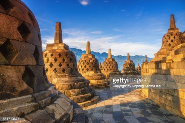 Stone stupas in a row at the Borobudur, Central Java, Indonesia.