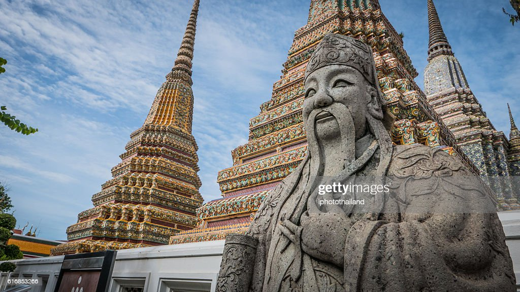 stone Thai - Chinese style sculpture and thai art architecture. : Stock Photo