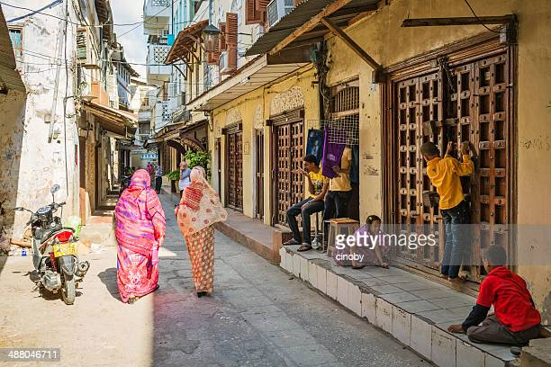 stone town city life - zanzibar stock photos and pictures