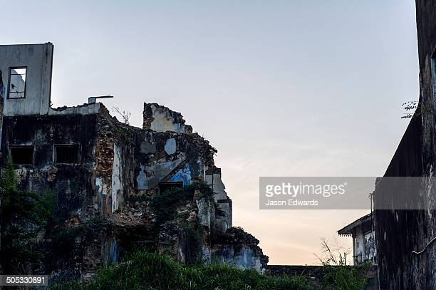 Dawn rises over the crumbling walls of a merchants house in an ancient trading port.