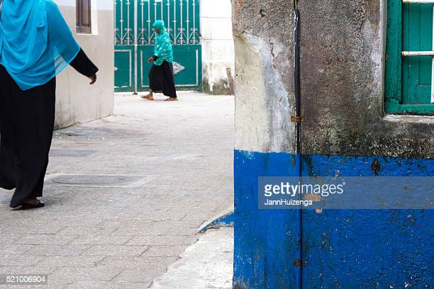stone town, zanzibar: women in bright headscarves/hijab - east africa stock pictures, royalty-free photos & images