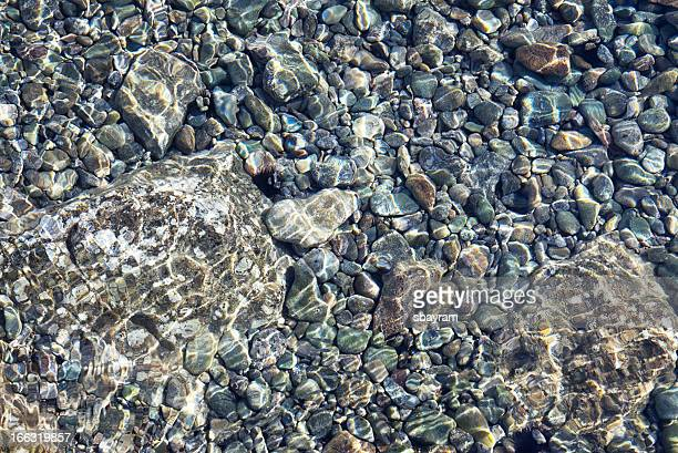 stone underwater - pebble stock photos and pictures