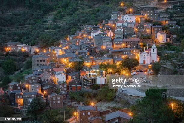 stone village at dusk - jeremy woodhouse stock pictures, royalty-free photos & images