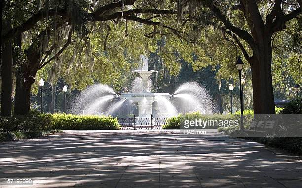 stone walkway and water fountain in the park - fountain stock pictures, royalty-free photos & images