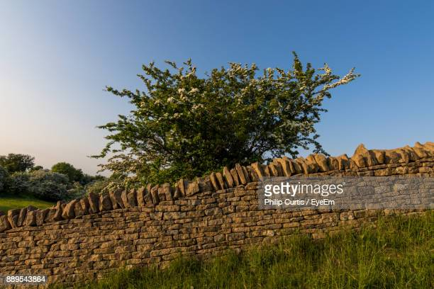 stone wall against clear sky - aldeburgh stock photos and pictures