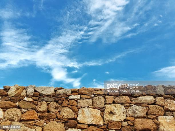 stone wall against sky - chandigarh stock pictures, royalty-free photos & images