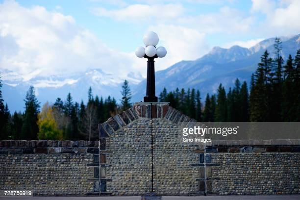 stone wall and street light with mountains in background, canada - image stock pictures, royalty-free photos & images