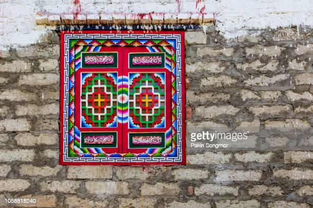 stone wall and window tibetan style - tibetan culture stock pictures, royalty-free photos & images