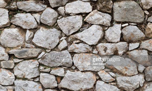 stone wall background - stone wall stock pictures, royalty-free photos & images