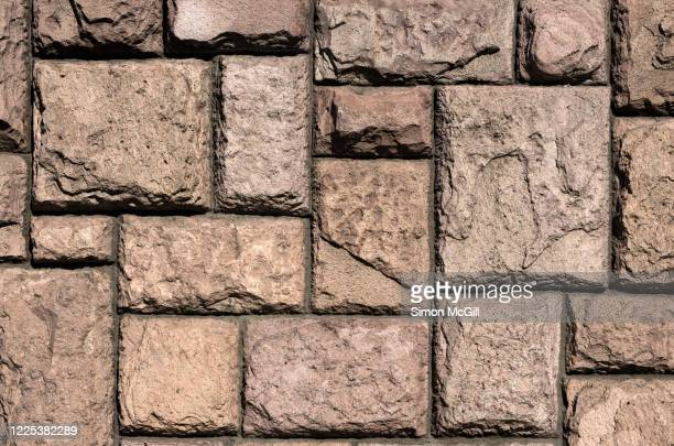 stone wall of different sized rectangle blocks - stone wall stock pictures, royalty-free photos & images