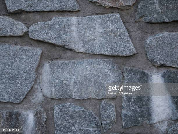 stone wall - leogang stock pictures, royalty-free photos & images