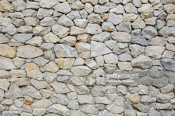 stone wall texture - stone wall stock-fotos und bilder