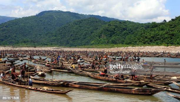BHOLAGANJ SYLHET BANGLADESH Stone workers collect stones in boats from the at Jaflong Stone Quarry field The crystal clear water of the Piyain River...