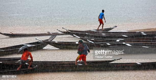 BHOLAGANJ SYLHET BANGLADESH Stone workers collect stones in boats from the Dholai river in Bholaganj During monsoon season boulders rocks stones and...