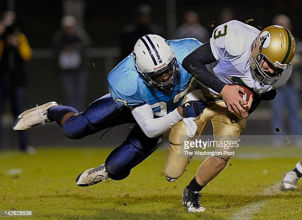 Stonebridge's defender Jonathan Allen left sacks Langley's QB Braden Anderson right as Stonebridge plays Langley in high school football at...