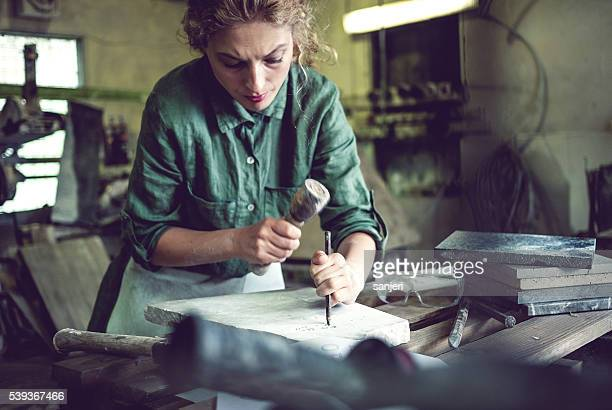 stonecutter woman portrait - sculptor stock pictures, royalty-free photos & images