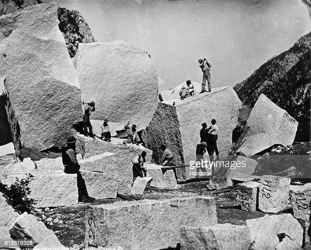 Stonecutters split granite boulders in Cottonwood Canyon Utah for use in building the Mormon Tabernacle in Salt Lake City All quarrying is confined...