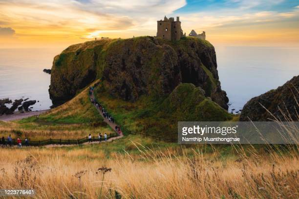 stonehaven, scotland august 28, 2018: dunnottar castle in the summertime shows the colorful sky when the sunset time located in stonehaven. - dunnottar castle stock pictures, royalty-free photos & images