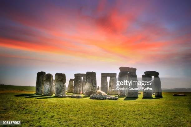 stonehenge against sky during sunset - stonehenge stock photos and pictures