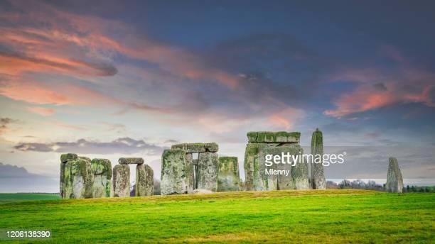 stonehenge colorful sunset twilight salisbury plain england - mlenny stock pictures, royalty-free photos & images